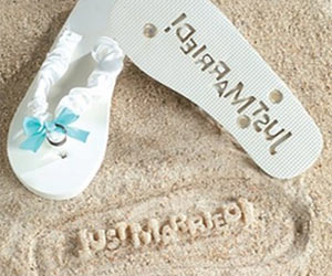 flip flops to stamp just married on sandy beach