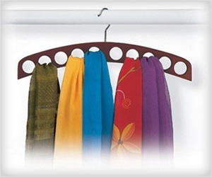 store scarves properly in dedicated scarf hanger in closet