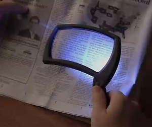 Magnifier glass with LED light for old senior people